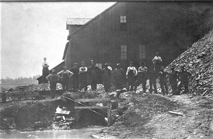Miners at the Lucky 12 in New Diggings, WI proudly stand among the lead piles.
