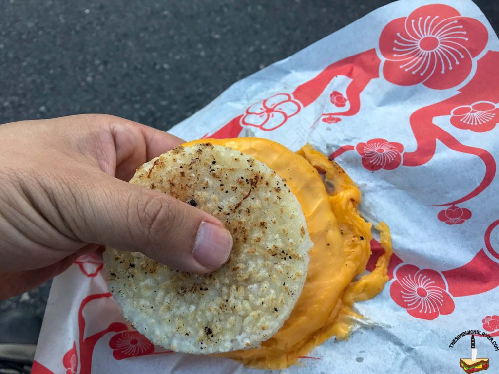 """The """"Tokyo Grilled Cheese"""" from Okamoto Kitchen. American Cheese with salt, pepper, soy sauce and mayo on crispy rice buns. It's super rich and needs something extra to finish it. Add pork belly for $3."""