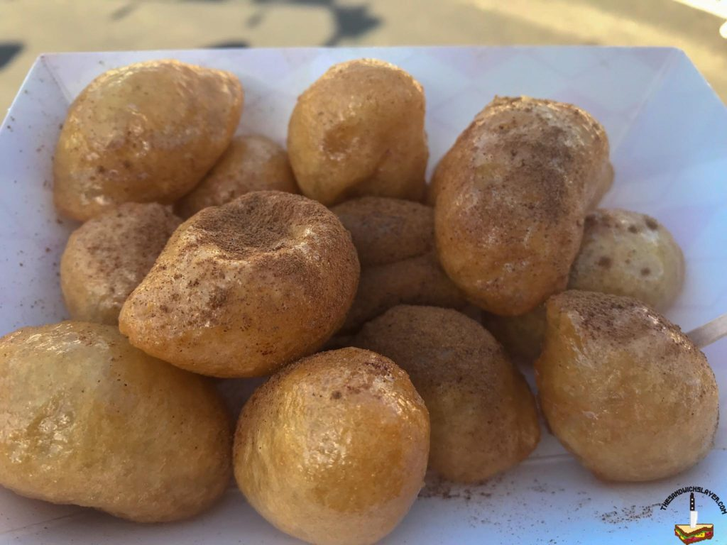 Freshly fried dough with honey syrup and cinnamon