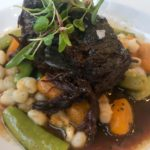 Braised Short Rib with hominy, sungold tomato, and snap peas