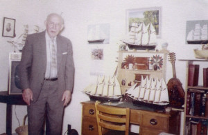 Frank Treat with his collection of model ships he built