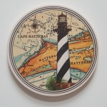 """Coasterstone featuring the Hatteras Lighthouse, Cork backing and absorbant, approx 4"""" in diameter"""