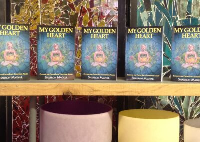 My Golden Heart books on shelf above colorful bowls