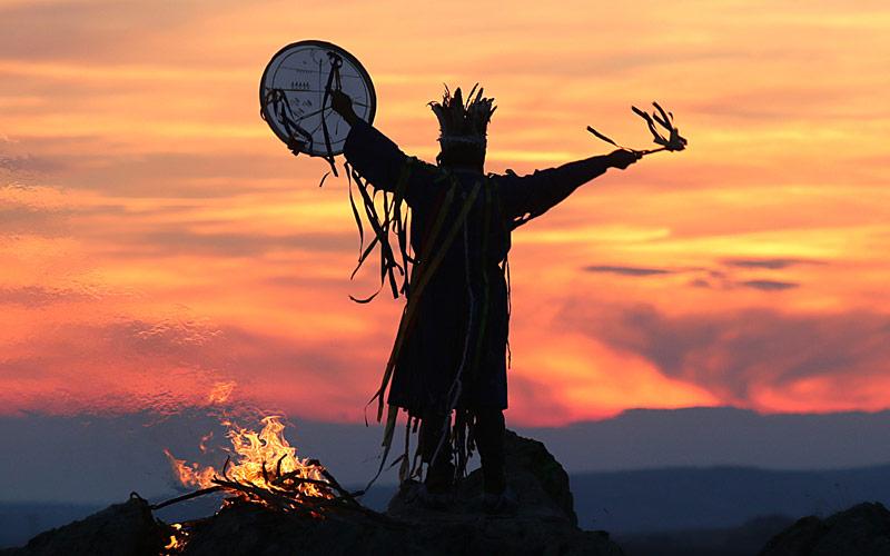 Shaman performing a ritual at sunset