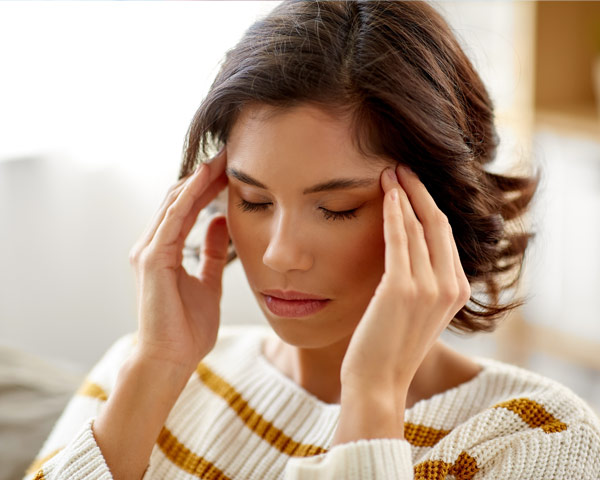Woman with eyes closed dealing with stress