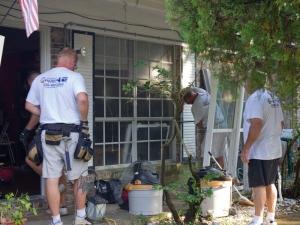 Majors Crew replacing entry door & windows