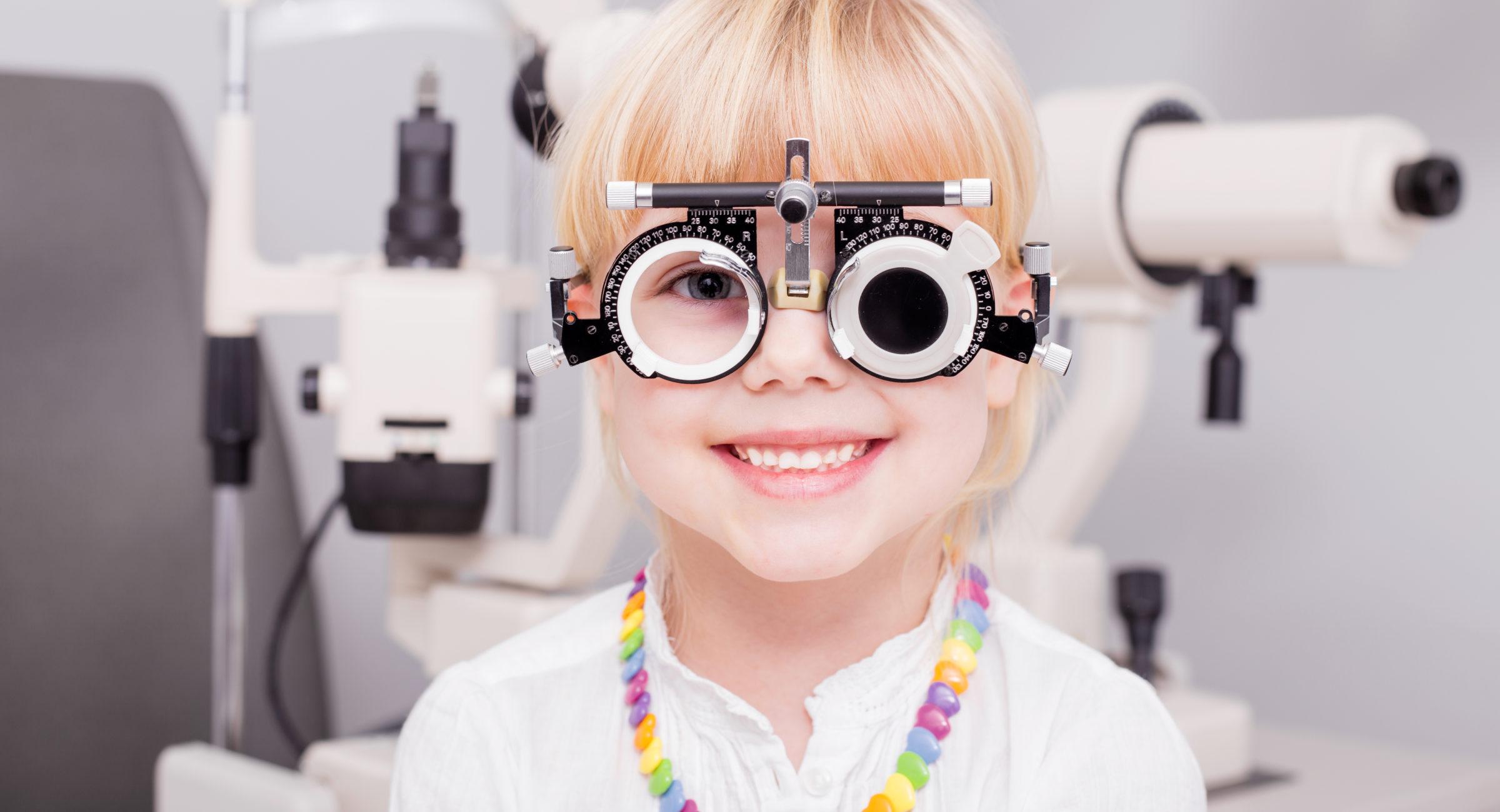 Little girl checking her vision