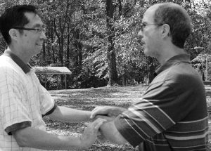 Kirk Talbott playing T'ai Chi with fellow T'ai Chi player at Cabin John Park