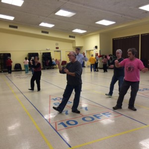 Chuck Lippman, Assistant Instructor leads a community T'ai Chi practice session at Schweinhaut Recreation Center in Montgomery County, Maryland.
