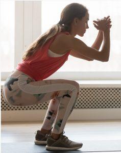 Woman posing in a perfect Kua Squat