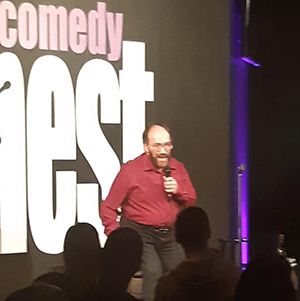 Michael performing comedy at Comedy Nest in Montreal.