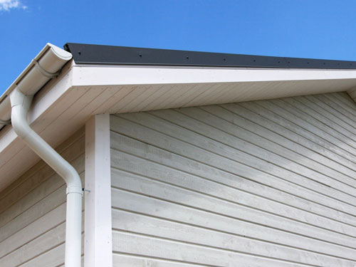 Corner view of a roof with a gutter