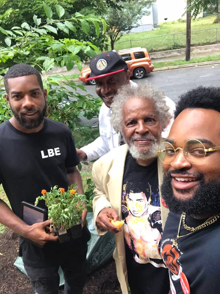 Tyrone w three men outdoors