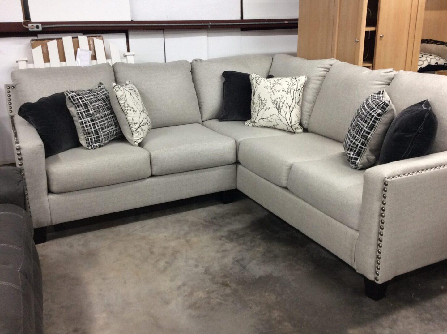 light gray sofa set with throw pillows