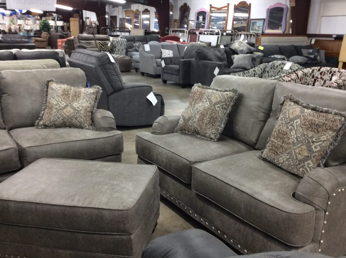 gray couches with throw pillows and other furniture