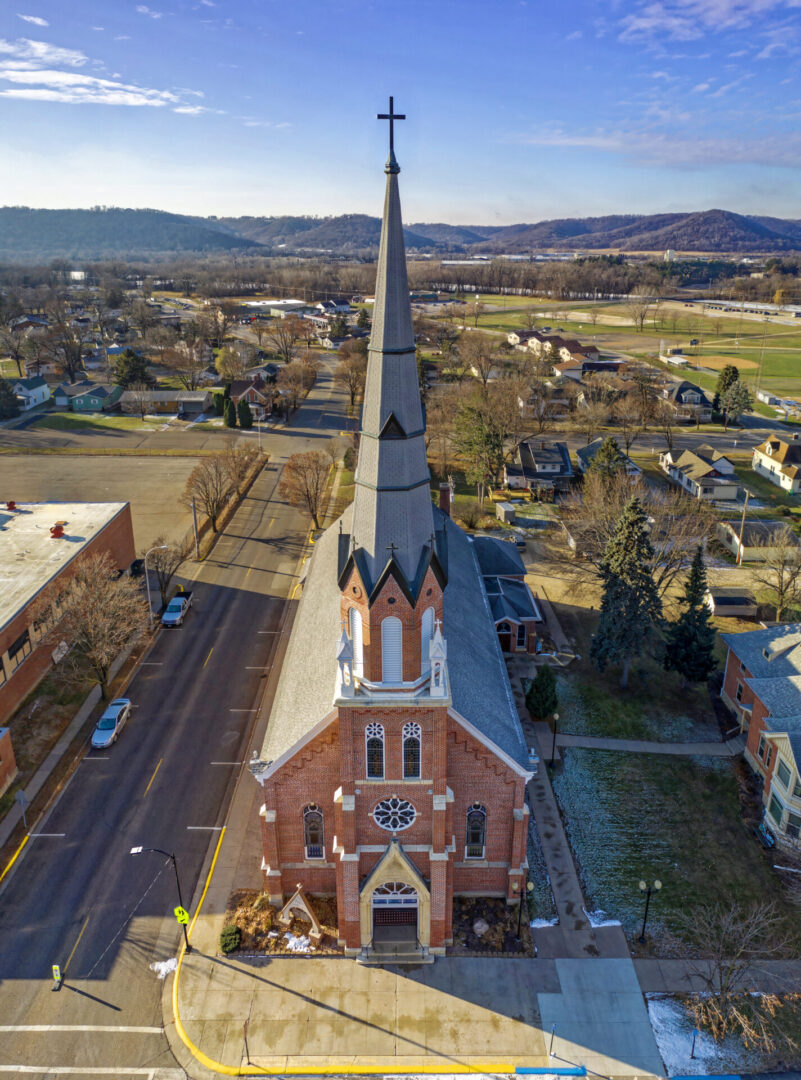 aerial-view-of-brown-and-gray-concrete-church-1624307