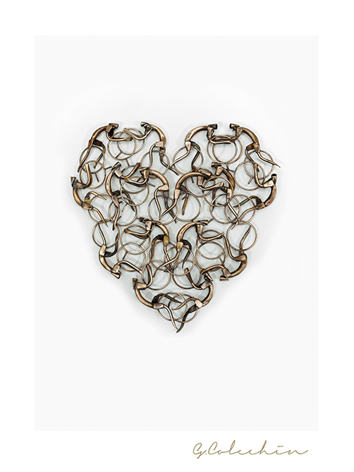 Heart made of copper cyclists