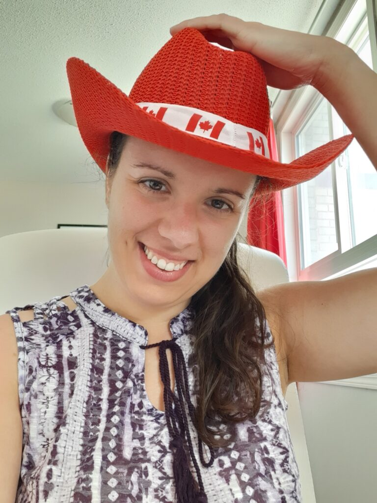 native French instructor smiling with red cowboy hat