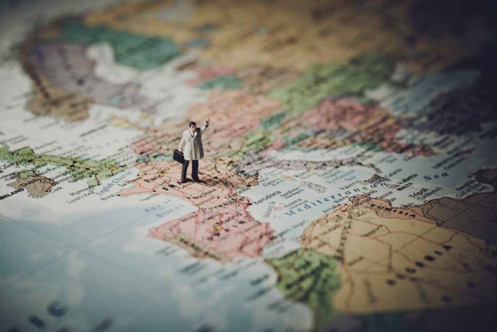 map of Europe with a little man holding a suitcase and standing on France