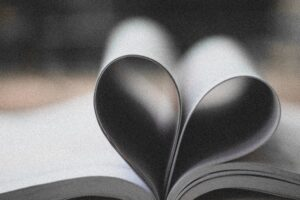 book with pages shaping a heart