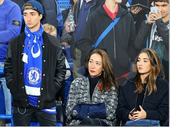 Matilde Faria watching a football match with her kids
