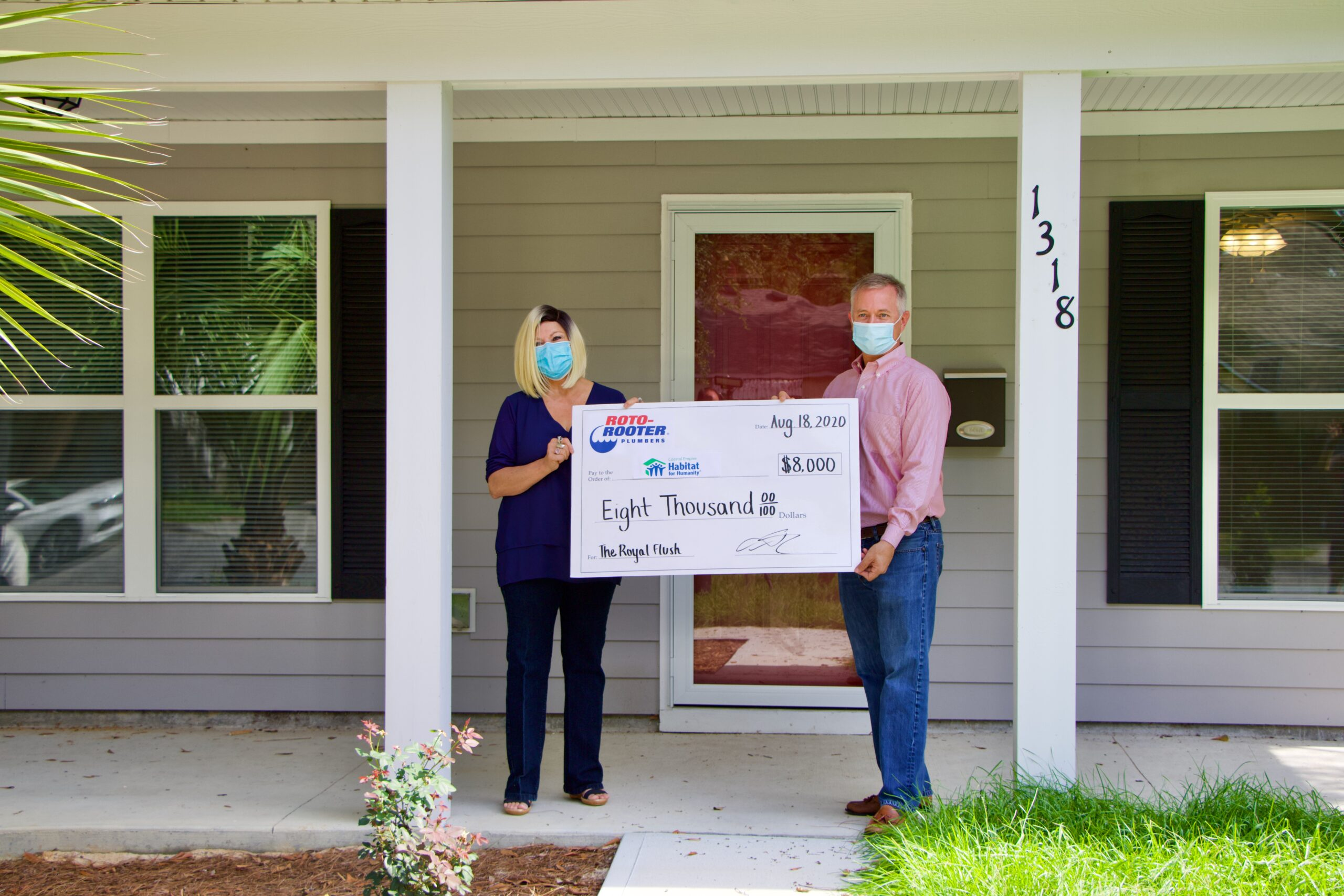 Roto-Rooter Plumbers of Savannah Presents 8,000 dollars to Habitat for Humanity