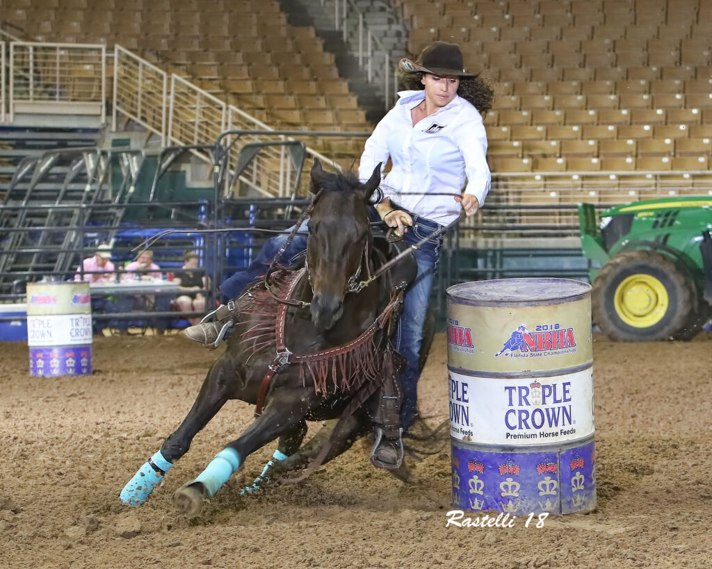 Holly and Benelli competing in the National Barrel Horse Association Finals in 2018.