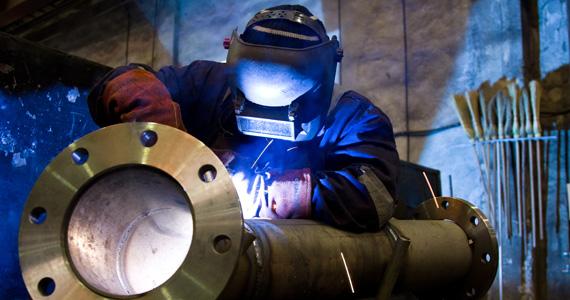 Custom fabrication expert working welding