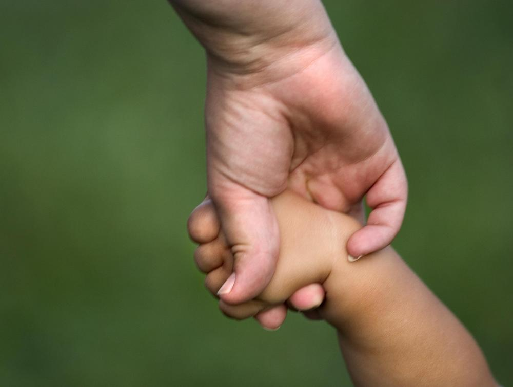 mother holding child hand