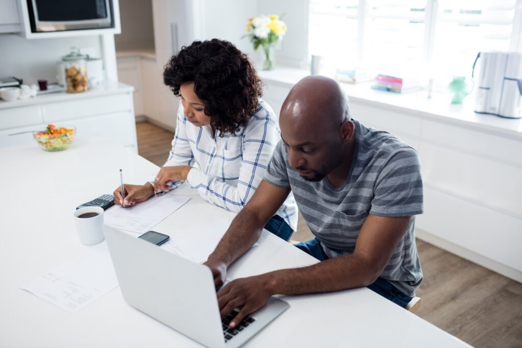 Couple checking bills worriedly