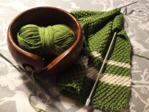 half knitted tea towel in green and white
