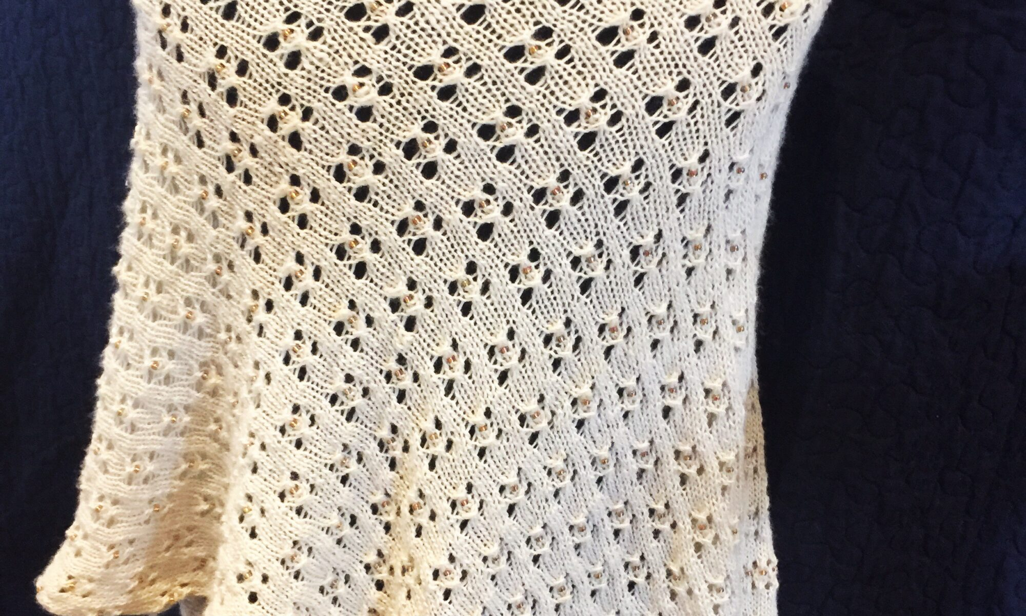 Ivory lace shawl on mannequin