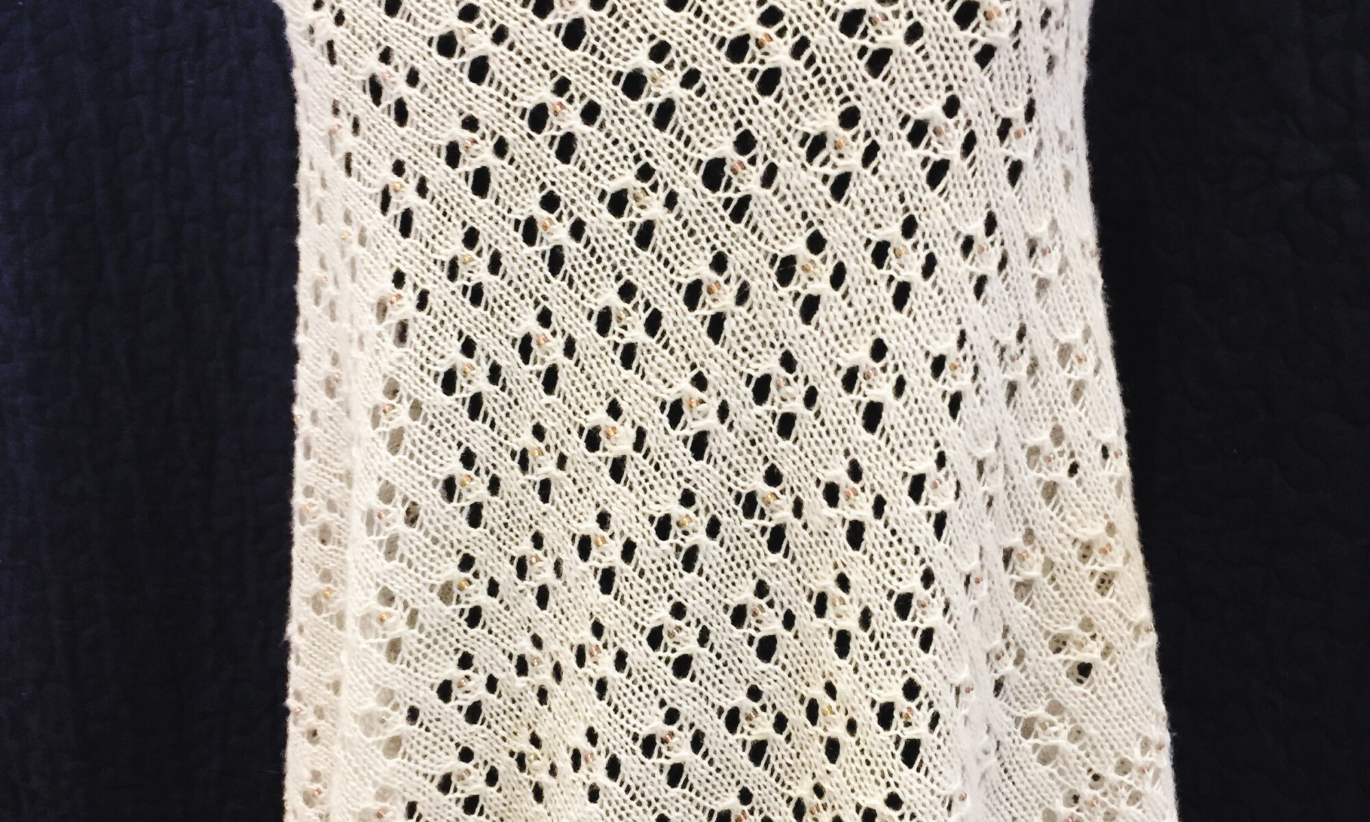 beaded lace shawl on mannequin