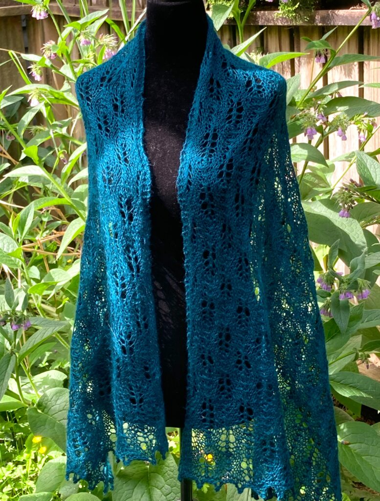 lacy scarf or wrap on a mannequin