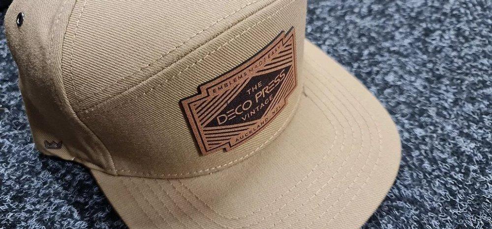Deco press hat emblem