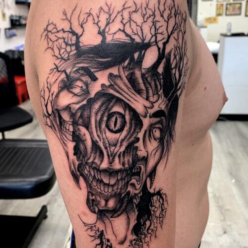 split face dark creepy japanese blackandgrey blackwork tattoo roots trees demon laughing sad mens tattoo