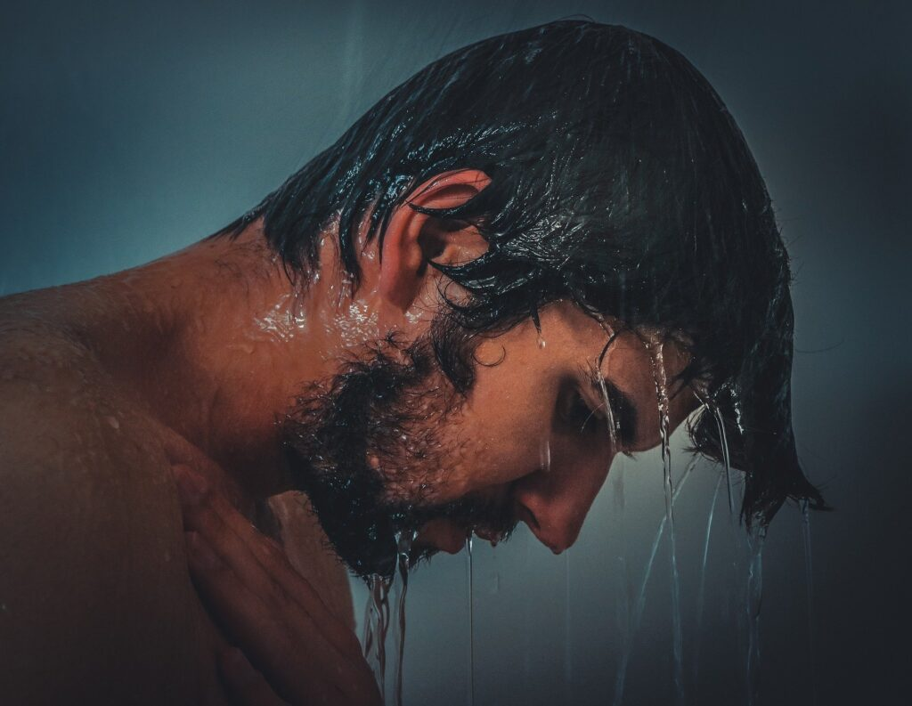 Man taking a hot shower