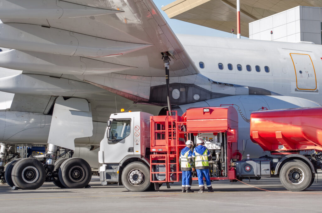 A truck fueling the aircraft, to illustrate making the final fuel decision.