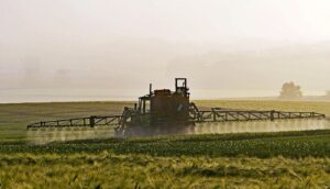 Spraying pesticides on a field