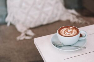 Cappuccino on a bedside table
