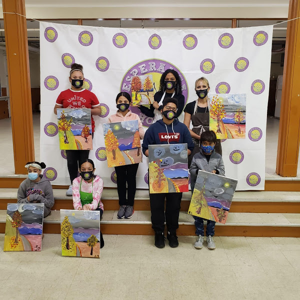 The participants holding their paintings