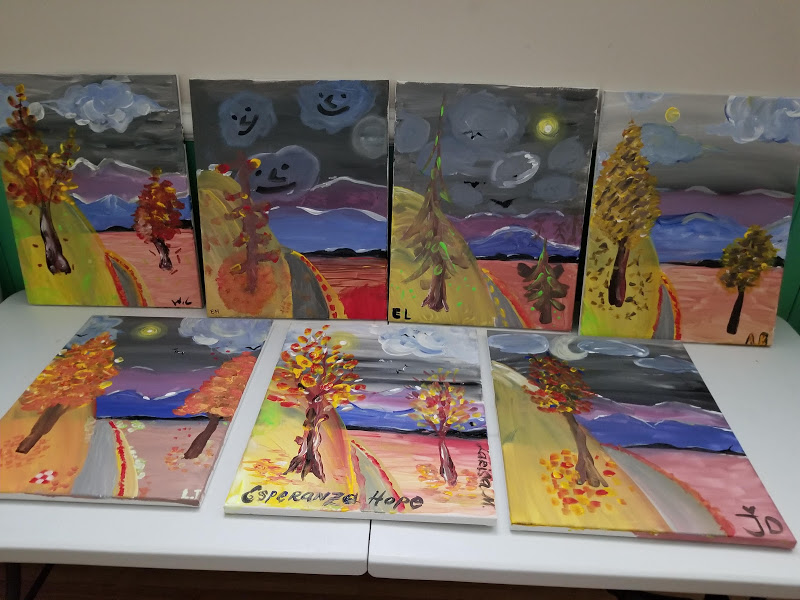 Seven paintings of two trees on a road to a mountain