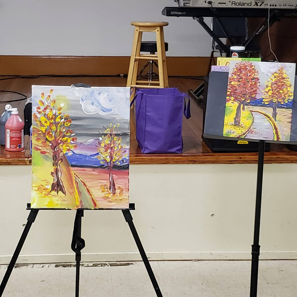 Two finished paintings on easels