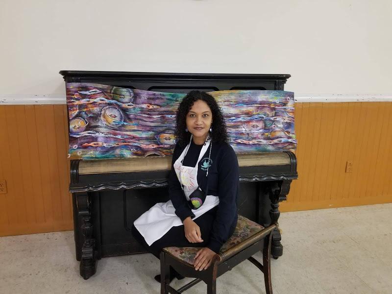 A woman sitting at a piano