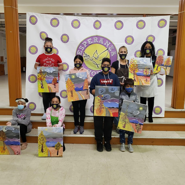 The participants holding their paintings (version 2)