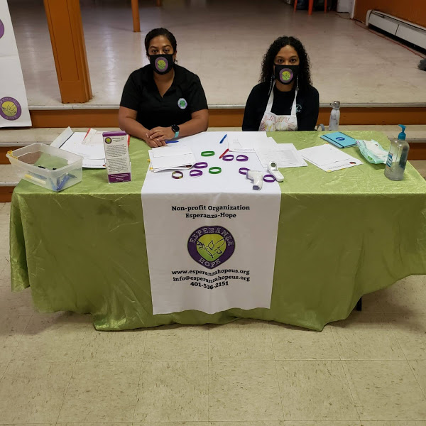 Two women wearing masks at the registration table