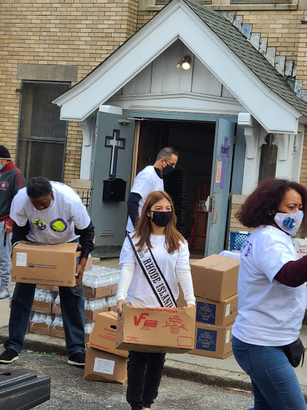 Ms. Rhode Island and our other staff carrying a box
