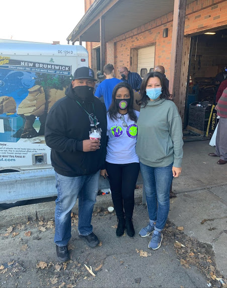 Three of our staff, all wearing masks