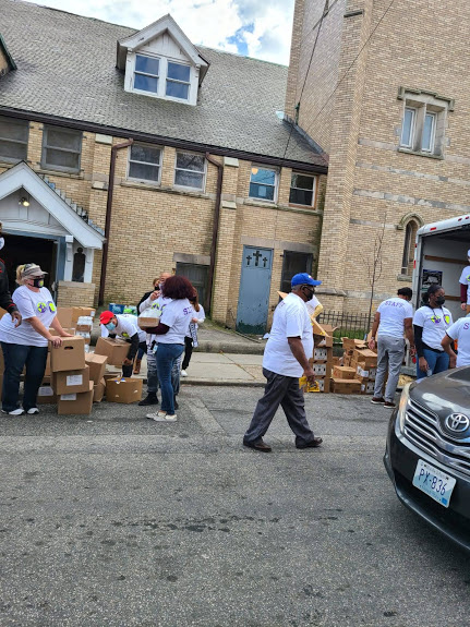 Our staff doing their roles in the food distribution