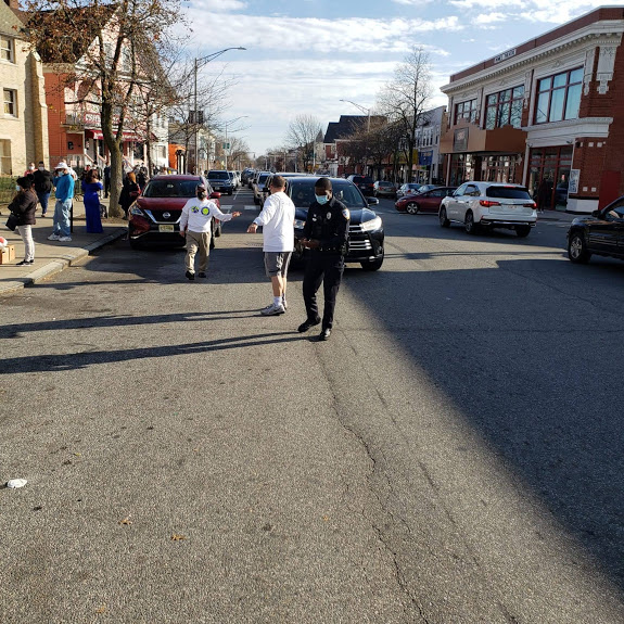 Our staff and a police officer signaling cars to pass by